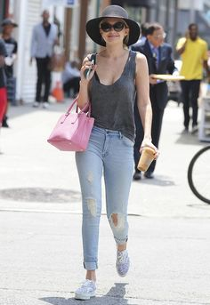 Distressed jeans, a slouchy gray tank top, and an awesome sun hat, canvas laced sneakers, pink handbag