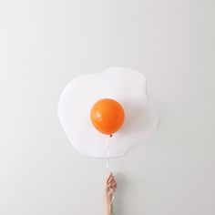 PhotographerPeechaya Burroughs' playfully minimalistic shots contain a contagious amount of positivity. Through Burroughs' unique lens, a yellow/orange balloon becomes a perfect egg yolk, food is transformed into artistic material, and origami is magically brought to life. No matter what the concept, each image showcases the artist's imaginative ability to see the extraordinary in everyday items. …