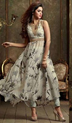 Simple yet stylish, this gray color georgette printed Anarkali pant style suit. The lace, printed and resham work on attire personifies entire look. #geogeretteanarkalisuit #floralprintanarkalis #anarkalidresses