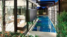 Lap pool in narrow space beside a house. Pinned to Pool Design by Darin Bradbury.
