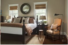 neutral bedroom with textured rug and windows