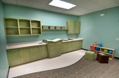 Love the built in cabinet space with sink and changing table. Also note the hole in the counter for the diapers. Church Nursery Decor, Nursery Room, Church Building, Building For Kids, Kids Church, Church Ideas, Sunday School Classroom, Preschool Rooms, Classroom Layout