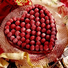 Raspberries and chocolate--two flavors that seem made for other--are especially delicious in this Valentine torte recipe.