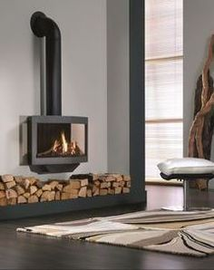 A Sweden stove with modern design is fast becoming the focal point in the Interior – we show you 25 stylish models from renowned manufacturers that have a t Foyers, Free Standing Wood Stove, Direct Vent Gas Stove, Decoration, Lounge, Home Appliances, Inspiration, Contemporary, Living Room
