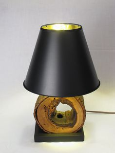 Night Stand Lamps from Wood Logs - Desk Lamps -  These unique and natural night stand lamps are made from upcycled cross section slices of a hollow sweetgum log and mounted to a black painted …    Read More »  #Bedside #Diylighting #Farmhousedecor #Gold #Handmadelighting #Hugelighting #Lamp #Lampshade #Lightbulb #Lightfixture #Lighting #Lightingdesign #Modernlighting #Oak #Recycle #Rusticlighting #Vintagelighting #Woodlamp #Woodworking
