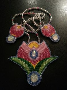 Earrings and medallion by Wazi