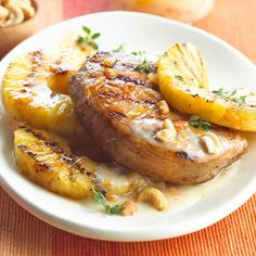 Grilled Pork and Pineapple Turn a classic pork chop into a totally tangy, tropical meal. Orange marmalade creates a mouthwatering glaze and a refreshing topping when mixed with yogurt. Grilled pineapple slices on the side lend their bold sweetness to this new grill-season favorite. Budget dinner price: $2.67 per serving