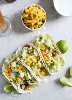 Beer Battered Fish Tacos with Mango Margarita Salsa and Jalapeño Crema I howsweeteats.com