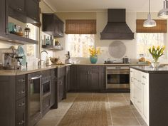 The Shaker cabinet-style inspired Pearson cabinet door style in grayish dark Weathered Slate maple from Kitchen Craft Cabinetry is an adaptable resource for a surprising variety of kitchen cabinet designs, from traditional to contemporary and transitional. http://www.kitchencraft.com/
