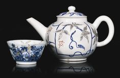 A very rare Chelsea teapot and cover, circa 1752-54 the faceted body moulded with strawberry leaves, resting on four feet, finely painted probably by Jefferyes Hamett O'Neale, with cartouches of travellers and cattle in pastoral landscapes, two insects and a bouquet of flowers at the spout, the cover with a vine finial, red anchor mark,