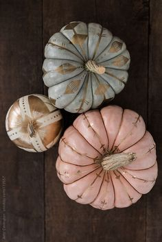 Pastel pumpkins painted with gold paint by Amy Covington - Stocksy United - Royalty-Free Stock Photos