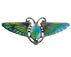 From eriebasin.com  1910s Egyptian Revival Enamel Brooch  Sterling Silver, Enamel  A gorgeous English Egyptian revival brooch in the form of a winged scarab. Inset with beautiful lime green and turquoise enamel.
