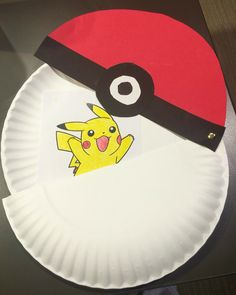 Paper plate pokeball. Color your favorite Pokemon and use two paper plates, construction paper, and a brad to make this.