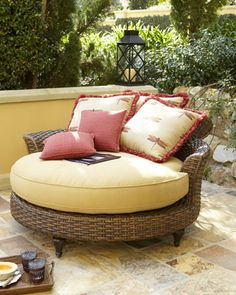 """Can't you picture """"living the life"""" and lounging on this baby?!    Outdoor Circular Chaise at Horchow."""