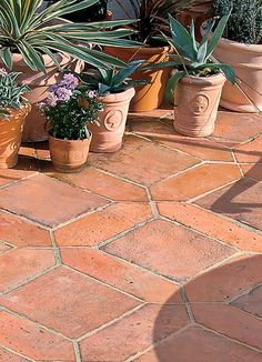 Mellow Terracotta tiles by www.Bradstone.co.uk are a great way to create a Meditterranean haven in a small space .