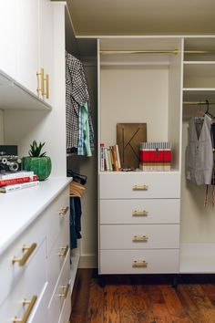 Stunning White Walk In Closet With Brass Accessories By Classy Closets.  Schedule A Free
