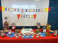 Pool party cake table and candy buffet.
