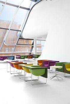Stua furnishes Wien University by Zaha Hadid Nube armchairs and Marea tables