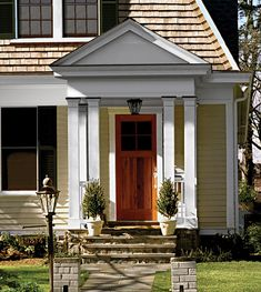 this old house front door awning - Google Search Front Door Awning, House Front Door, Front Door Makeover, Exterior Makeover, Fiberglass Columns, Creole Cottage, Decorative Planters, Model Homes, Old Houses