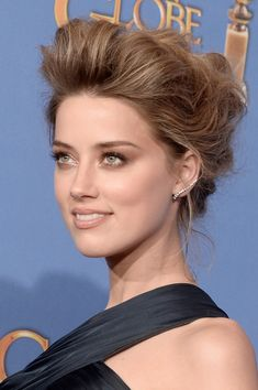 Amber Heard's teased updo and bronzed makeup.