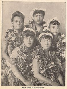 Hula dancers. Funny how times change but don't. We now wear our haku lei po'o across the forehead and around parallel to the floor.