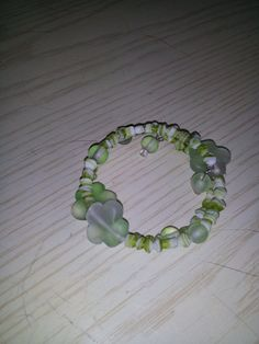 Check out this item in my Etsy shop https://www.etsy.com/listing/156623106/green-and-white-shell-and-flower