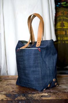tote made from cone mills selvedge denim. leather handles, copper rivets. available.