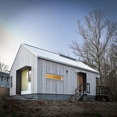 Eastern white cedar with Cabot's bleaching oil, gavalume standing seam roof