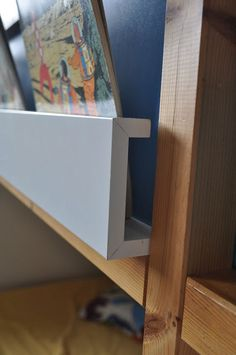 """This is a very good idea for simple slide-in bookshelf. Noted!"" The RIBBA (mounted sideways) provides an excellent bookshelf! Books/Comics slide in and out easily."