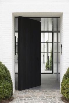 gorgeous white brick exterior with black door opening to an entry with view to the back : the stone walkway transitions well into the entry flooring (perfect for kids and dogs) - Daily Home Decorations The Doors, Entrance Doors, Windows And Doors, Door Entry, Front Doors, Entry Foyer, Style At Home, Exterior Design, Interior And Exterior