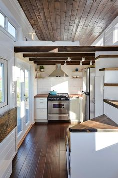 I don't know about you, but cooking a hearty meal is a sort of meditation, and having a nice kitchen is a the sanctuary where you can find peace. One look at the slick stainless range in the kitchen of this beautiful build and you'll agree, it's something special. And it doesn't end there either, because there are all kinds of clever built-ins, like ...