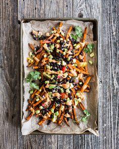 Sweet Potato Nacho Fries / sweet potatoes, raw cashews, tomato paste, nutritional yeast, lemon, cherry tomatoes, red onion, avocado, cilantro, lime, black beans