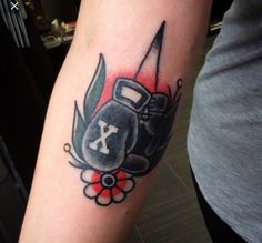 Traditional boxing glove tattoo