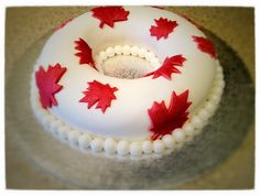 Born in Canada, I am very proud of my roots. My mum's birthday was in April and because I know how much she misses our lovely family on the other side of the pond, I decided to make her a tasty cake to take her home. Even if it was only for a few minutes.  This beautifully soft 100% Canadian maple syrup and yogurt pound cake did just that. (message me for recipe)  I wanted to keep the Canadian theme so decorated the cake in beautiful flag style maple leaves in the traditional red and white