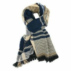 "Plaid and Chevron Blanket Scarf This ultra-cozy woven scarf doubles your style potential with a cute print on each side: chevron plus exploded plaid! The oversized, fringe-trimmed shape is wrap scarf perfection!  How it fits: 31"" wide by 72"" long; 1"" fringe Fabric & care: acrylic / hand wash Accessories Scarves & Wraps"