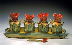 """""""Tulip Garden""""  Ceramic Jam/Condiment Set    Created by Peggy Crago  Four sculptural jars, with spoons, on a tray. Hand-built and finished with majolica glaze. Food and dishwasher safe.     