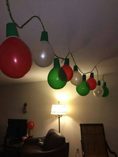 For ugly Christmas sweater party.Giant Christmas lights made out of balloons Christmas Lights Garland, Office Christmas Decorations, Light Garland, Christmas Balloons, Grinch Christmas Decorations, Office Party Decorations, Desk Decorations, Christmas Decorating Themes, Christmas Decorations For Classroom
