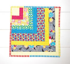 Quilt Now BOM Month 1 - Quarter Log Cabin mini quilt in Gardenvale by Jen Kingwell.