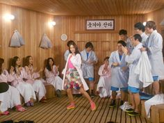 Kshow: Happy Together.  A Korean talk show set in a sauna or cafeteria where they interview guest celebrities.  Yoo Jae suk is the main host.  They've recently added a late night food/cooking battle btwn guests that in my opinion is the best part of the show now.