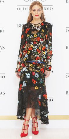 Olivia Palermo celebrated the launch of her Ciate London collaboration in an exquisite floral-embroidered Preen dress that she styled with statement BaubleBar jewelry, a skinny belt, and red T-strap pumps.