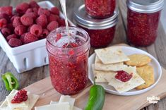 Classic raspberry jam gets a spicy kick when you add jalapenos to the recipe! Great over cream cheese or baked brie, this jam can bring life to any table. Raspberry Jalapeno Jelly, Jalapeno Jam, Jalapeno Pepper, Raspberry Syrup, Raspberry Recipes, Jam Recipes, Canning Recipes, Yummy Recipes, Kitchens