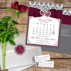 This modern and romantic charcoal gray and white damask wedding save the date card with mini calendar has a rich burgundy colored printed on ribbon and bow across the top of the card. A pair of printed on joined hearts jewels and burgundy simulated glitte Best Wedding Venues, Wedding Themes, Wedding Tips, Wedding Details, Wedding Planning, Wedding Save The Dates, Save The Date Cards, Burgundy Wedding Theme, Damask Wedding