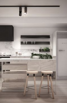 pale wood kitchen stools, marble backsplash, black cabinet. is that a mirrored island!?