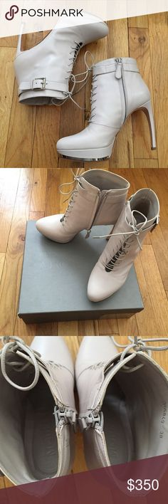 Platform Lace Up Heel Boot Alexander McQueen platform lace up heeled bootie. Silver metal detail at bottom, zipper on side to easily put on and take off. Coated laces. Pretty creamy color. In great condition and only worn once. Comes with original box, dust bag and tags! Alexander McQueen Shoes Heeled Boots