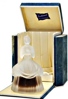 1948 Eisenberg Excitement, figural perfume bottle and stopper, frost glass, flocked paper box.