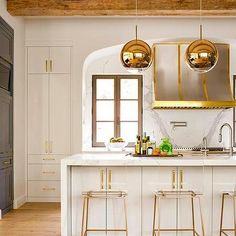 Copper Globe Light Pendants with White Marble Waterfall Kitchen Island