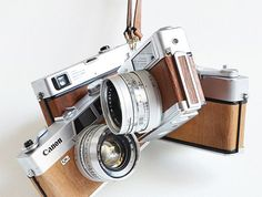 Vintage cameras re-imagined by Ilott Vintage. They replace the original leather with wood veneer.