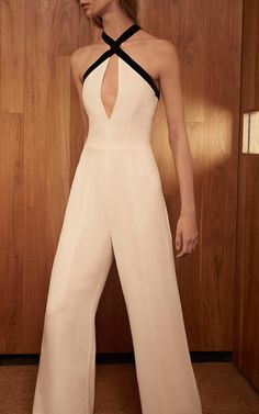 This **Alexis** Molly Keyhole Halter Jumpsuit features a contrasting halter neckline, cutout at bust, and a sleeveless design.