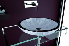An elegant contemporary round basin hand polished in Vinci, Italy.   Functional and visually sensual, this basin will make a statement in any bathroom.