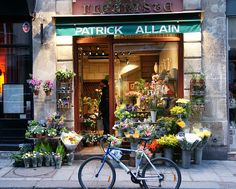 Flower Shop by kanooka, via Flickr~Paris France----in another pin you can see top of the building-spectacular